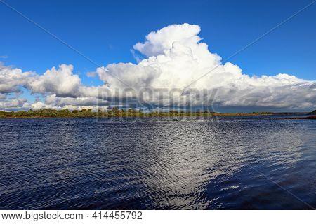 Large White Cumulonimbus Cloud, Thunderstorm, Over The Neman River
