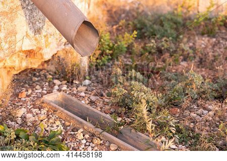 Storm Sewer With Grate. Drainage Of Rainwater Into A Storm Ditch. How To Make The Drainage Of The Si