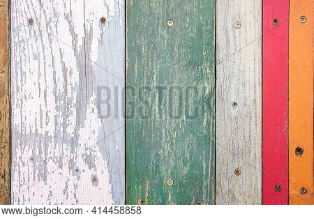Close Up Of Faded Paint On Rustic Vertical Wood Planking