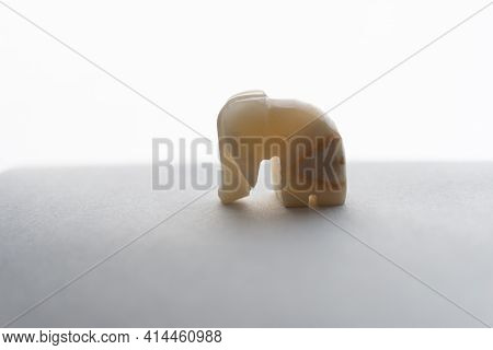 A Product Made Of Onyx Is An Elephant, A Souvenir, A Statuette.