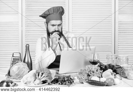 Chef Laptop Read Culinary Recipes. Culinary School. Hipster In Hat And Apron Learning How To Cook On