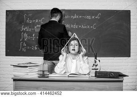 Solving Task. Man Writing On Chalkboard Math Formulas. Teaching In University. High School. Universi