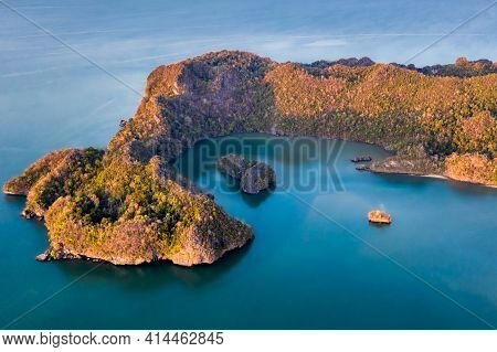 Langkawi Malaysia Aerial Ocean Cove During The Morning Golden Hours. Soft Blue Ocean Waters And Seve