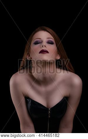 Low Key Make Up And Beauty Portrait Of A Sensual Young Woman With Red Lipstick And Closed Eyes, Posi