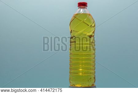 Bottles Of Edible Soy Oil On Blue Background.