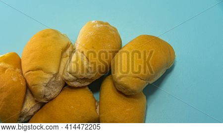 French Bread On The Blue Background Made By Industrial Process. Wheat Bread. Food Consumed At Breakf