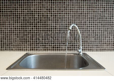 Interior Of Kitchen With Sink Basin Faucet Open Chrome Flowing Water. Conceptual Of Someone Forget T