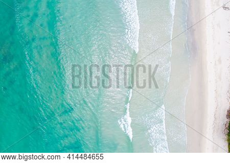 Clear sea water on sand beach aerial view