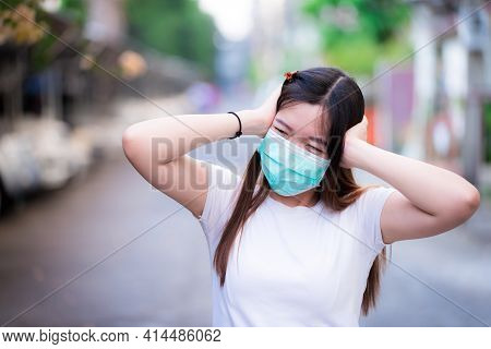 Asian Women Showed Signs Of Frustration As New Virus Spread And It Affected Economy. Woman Wearing A
