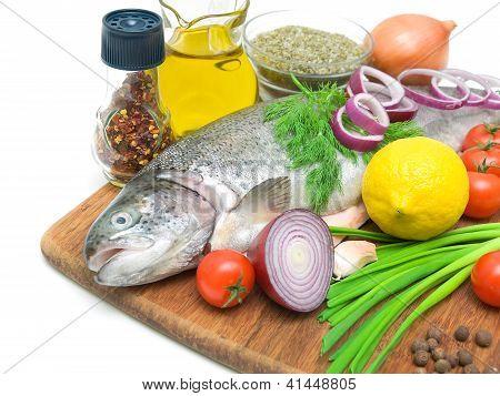 Fresh Trout, Vegetables, Lemon And Spices Close Up