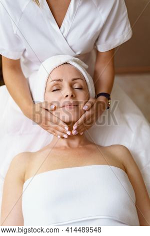 Face Massage. Close-up Of Adult Woman Getting Spa Massage Treatment At Beauty Spa Salon. Spa Skin An