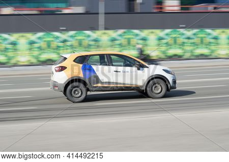 Moscow, Russia - March, 2021: Yandex Drive Carsharing Car Rushes Along City Street With Motion Blur