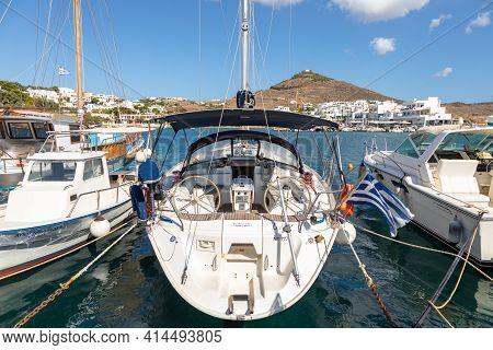 Piso Livadi, Paros Island, Greece - 27 September 2020: Boats And Sailing Ship Moored At The Harbor W