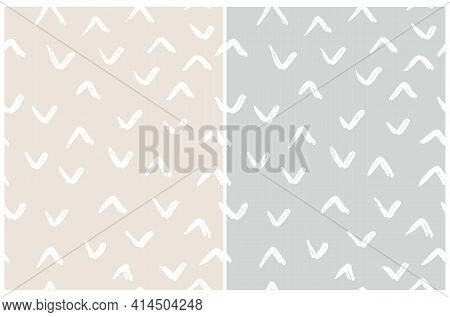 Simple Irregular Geometric Seamless Vector Patterns. White Hand Drawn Spots Isolated On A Light Beig