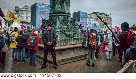 Hamburg, Germany - July 2 2017: Policmen Between Demonstrants During Colourful And Peaceful Demonstr
