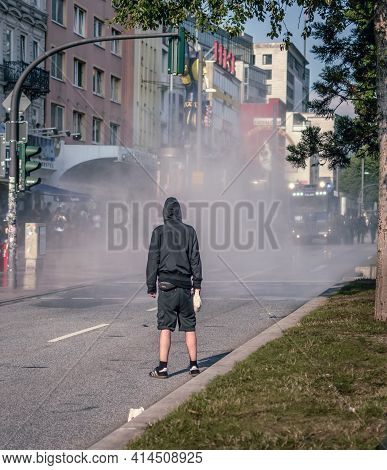 Sternschanze Hamburg - Germany July 7, 2017: Single Protester Stand In Front Of Police Water Cannon