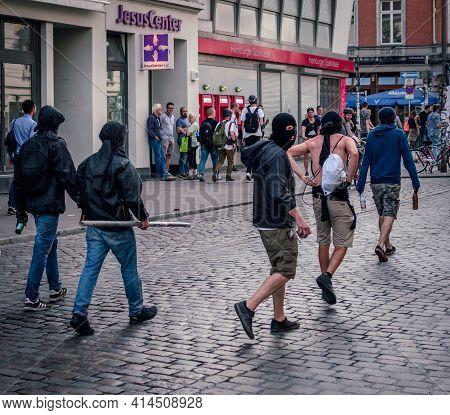 Sternschanze Hamburg - Germany July 7, 2017: Masked Protesters Walk Down A Street In Sternschanze Ar