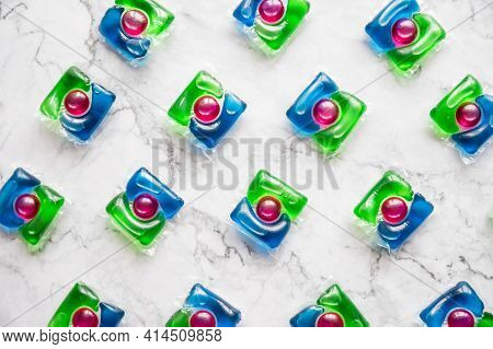 Pattern Of Liquid Laundry Detergent Pod. Washing Gel Capsules Close Up.minimalism.housework Concept.