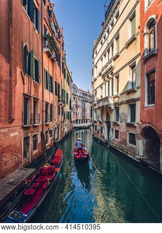 Scenic Canal Ride With Venetian Gondola In Colorful Channel, Top Tourist Summer Activity In Venice,