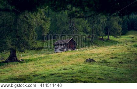 Hay Hut On The Meadow In The Foothills Of The Alps