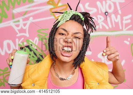 Swag. Fashionable Hipster Girl Rapper With Dreadlocks And Golden Teeth Goes Out To Paint In Public P
