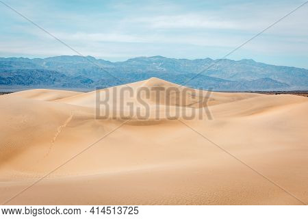 Contrasting Light And Shadows On Sand Dunes And Mountains In Mesquite Flat, Death Valley National Pa