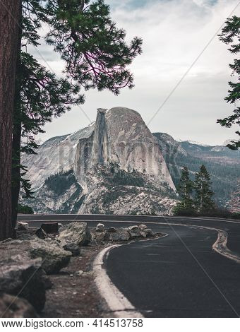 Beautiful View Of Winding Glacier Point Road With Famous Half Dome Summit In Golden Evening Light At