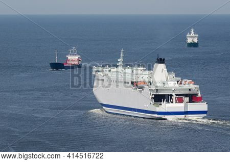 Maritime Transport - Passenger Ferry And Freighters Go At Sea