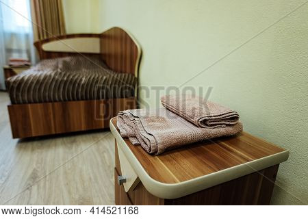 A Room In A Cheap Hotel. Minimalistic Interior Of An Economy Class Hotel Room. Overnight Stay For Th
