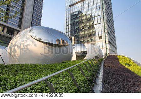 Shanghai, China. October3, 2015.  Large Reflective Art Sculptures Outside An Apartment Complex On Th