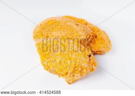 Three Slices Breaded Chicken Fillet In The Form Of A Medallion, Sliced On A White Background. Chicke