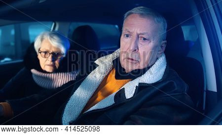 Elderly Couple In The Car Confused With Flashing Police Lights. Speeding Ticket. Man And Woman Havin