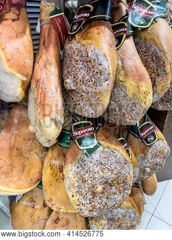 Bracciano, Rome, Italy - March 26, 2021: Cured Mountain Hams Hanging, Typical Umbrian Products Produ