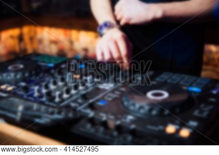Abstract Blur Dj Hands On The Remote. Dj Controlling And Moving The Mixers In Music Remote.night Clu