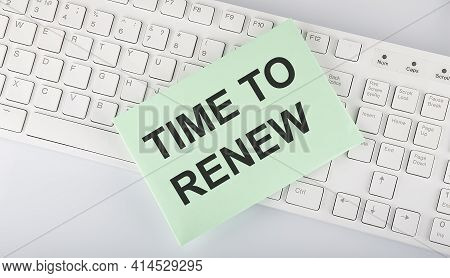 Text Time To Renew On Envelope On Keyboard On White Background