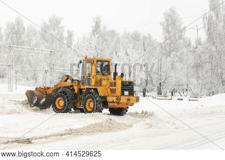 Municipal Service Grader Cleans Snow After Blizzard