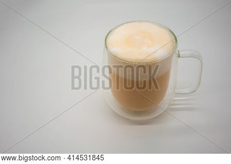 Hot Thai Milk Tea With Milky Foam Sprinkle With Cocoa Power For Decoration In Double Wall Glass Isol