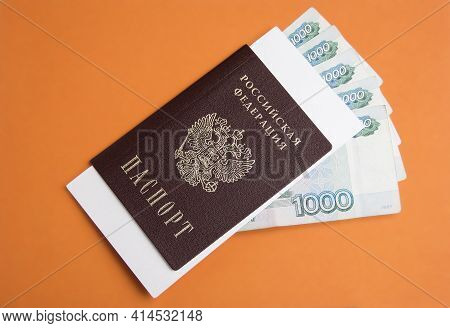 Russian Passport With 1000 Rubles Money On An Orange Background With A Place For The Text. Inscripti