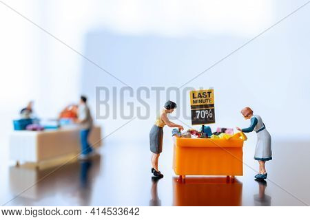 Miniature People , Shoppers With Discount Tray For Shopping Discounted Items