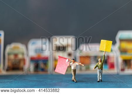 Miniature People, Protesters Holding Signs, Raising Their Hands For Revolution Or Protesting Concept