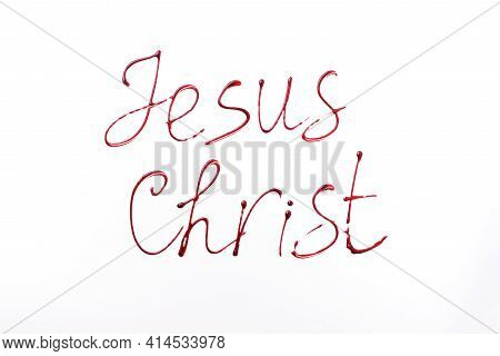 Name Jesus Christ Written With Blood Isolated On White Background. Top View. Palm Sunday, Good Frida