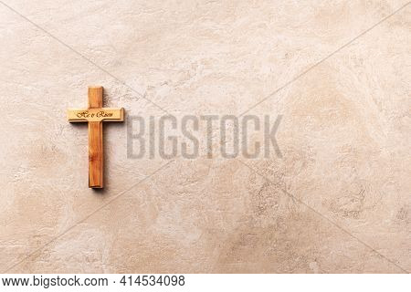 Wooden Cross With Text He Is Risen On Marble Background. Reminder Of Jesus Sacrifice And Christ Resu