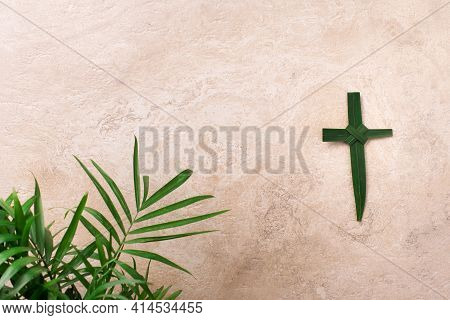 Palm Sunday Concept. Cross Made Of Palm And Tropical Leaves. Christian Moveable Feast To Celebrate J