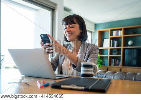 Young Woman Working At Home. Home Office.