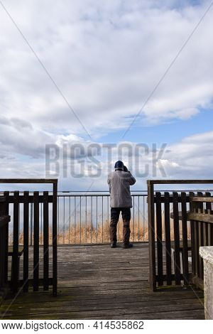Ornithologist Observing From A Platform By Seaside On The Swedish Island Oland