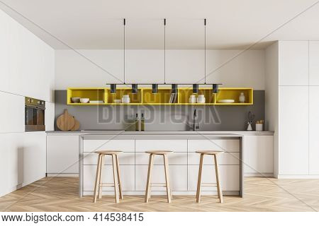 Wooden Kitchen Room With Table And Bar Chairs, Wooden Floor. Kitchen Set Interior With Yellow And Wh