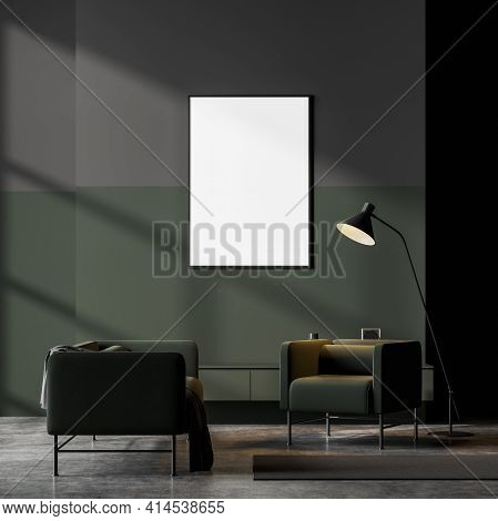 Dark Contemporary Waiting Room Interior With Two Green Armchair On Concrete Floor And Empty Framed P