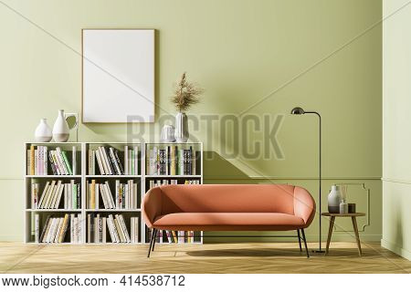 Cosy Waiting Room Interior With A Comfortable Couch And An Empty Poster On The Green Wall Above The