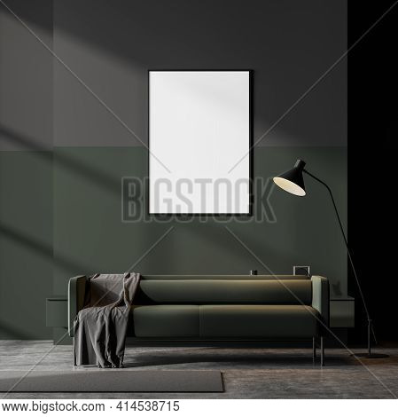Dark Scandinavian Living Room Interior With A Green Couch On Concrete Floor And Empty Framed Poster