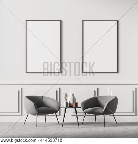 Waiting Room Interior With Two Posters In A Row On The White Wall, Comfortable Grey Armchairs And Sm
